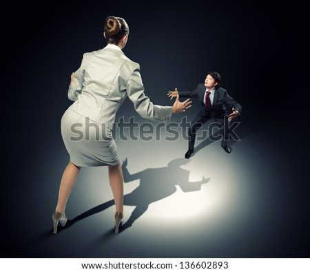 Image of businesspeople arguing and acting as sumo fighters - stock photo