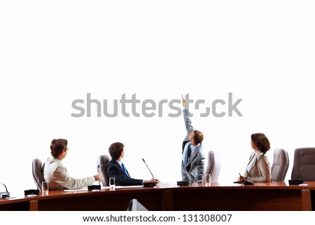 Image of businesspeople at presentation looking at screen. Space for advertisment - stock photo