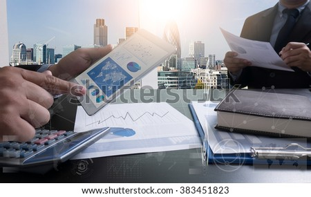 Image of businessperson pointing at document in digital tablet at meeting, business strategy digital layer effect at the office as concept - stock photo