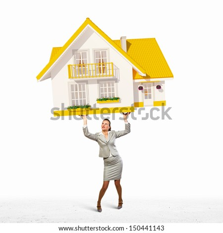 Image of businesswoman holding model of house above head - stock photo