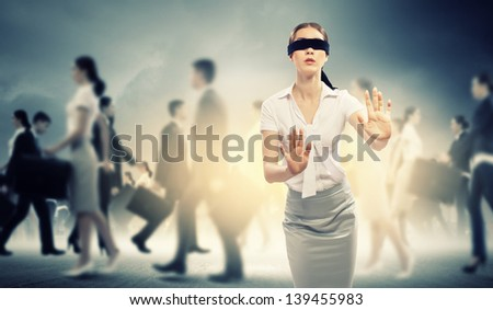 Image of businesswoman in blindfold walking among group of people - stock photo