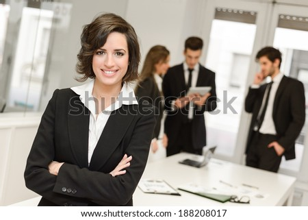 Image of businesswoman leader looking at camera in working environment  - stock photo