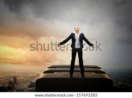 Image of businesswoman on top of building screaming - stock photo