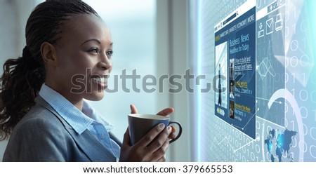 Image of businesswoman reading news on media screen - stock photo