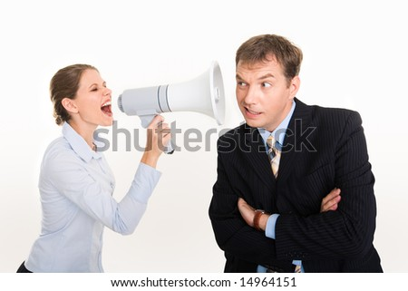 Image of businesswoman screaming by megaphone and businessman listening to her voice - stock photo