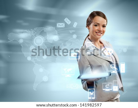 Image of businesswoman with tablet pc against high-tech background - stock photo