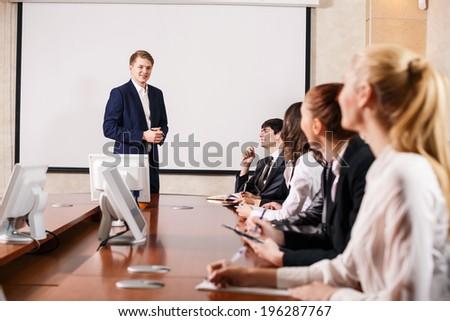 Image of businesswomen interacting at meeting - stock photo