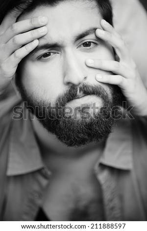 Image of calm man face with female fingers on it - stock photo