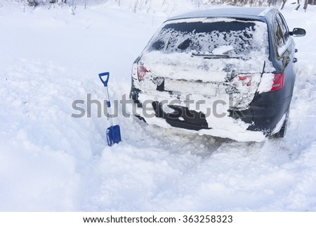 Image of Car stuck in snow  - stock photo