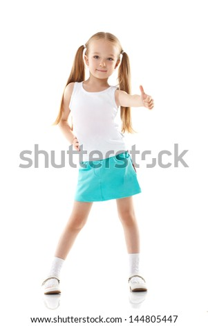Image of charming little girl showing thumbs up - stock photo