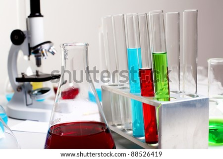 Image of chemistry laboratory equipment and glass tubes - stock photo
