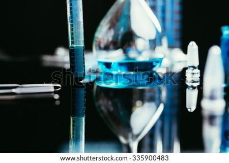 Image of chemistry laboratory equipment : tubes, pipettes, Erlenmeyer flask - stock photo