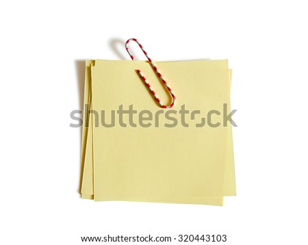 Image of color paper clip with yellow paper isolated on white background. Clipping path included. - stock photo