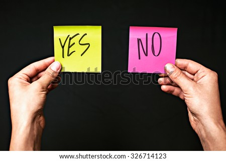 Image of colored stickers isolated on black background with the words yes and no. The concept of making the right choice, make the choice. - stock photo