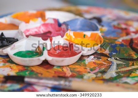 Image of colorful paints on palette for art background  - stock photo
