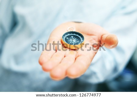 Image of compass in businessman hand - stock photo