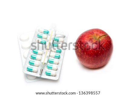 Image of composition with medicaments and apple. selective focus - stock photo