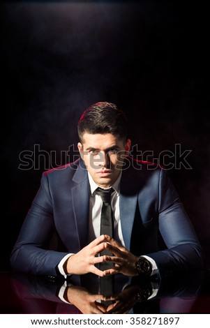 Image of confident and handsome co-worker in black suit - stock photo