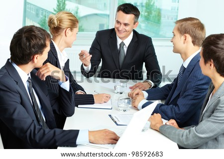 Image of confident boss voicing his ideas at meeting - stock photo