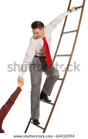 Image of confident businessman on ladder supporting man - stock photo