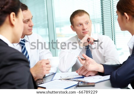 Image of confident colleagues listening to new ideas at meeting - stock photo