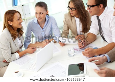 Image of confident partners sharing new ideas at meeting - stock photo