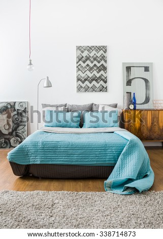 Image of contemporary stylish interior with comfortable bed - stock photo