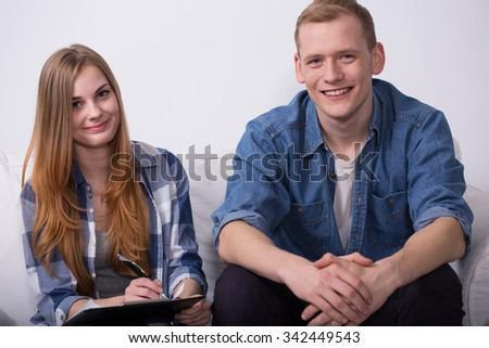 Image of content young pair changing flat - stock photo