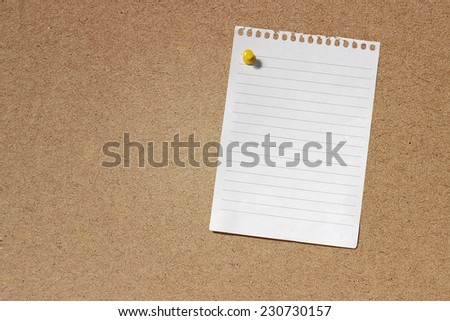 Image of Cork board with an empty note paper on it - stock photo