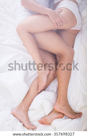Image of couple during erotic close embrace in bed - stock photo
