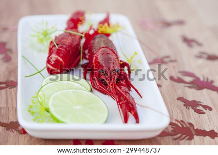 Image of crayfish and lime on a plate.  - stock photo