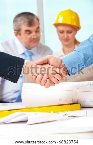 Image of customer and architect handshaking after making an agreement - stock photo