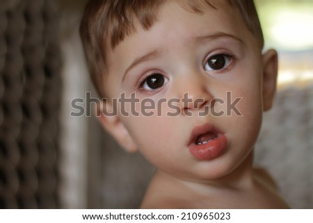 Image of cute baby boy, closeup portrait of adorable child's face, sweet toddler with huge eyes, healthy childhood,  perfect Caucasian infant, lovely kid, innocence concept - stock photo