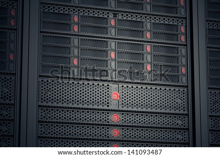 Image of data servers while working. Red LED lights are flashing. Image can represent cloud computing, information storage, etc. or can be the perfect technology background. - stock photo