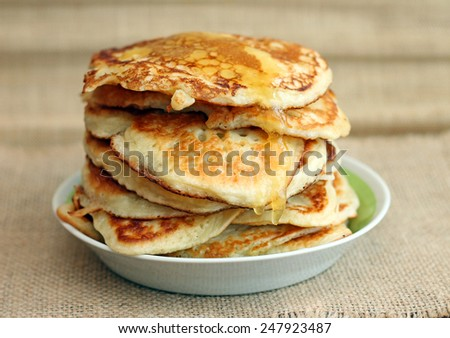 Image of delicious pancakes with honey, close-up - stock photo