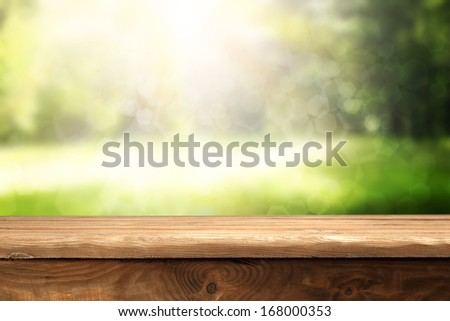 image of desk and garden  - stock photo