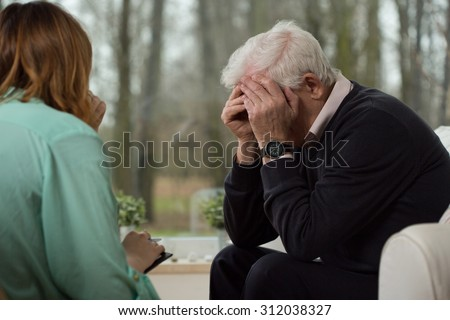 Image of despair elder man during psychological therapy - stock photo