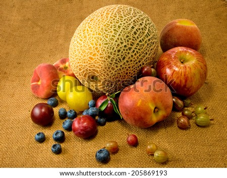 image of different fruits on the table closeup - stock photo
