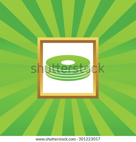 Image of disc pile in golden frame, on green abstract background - stock photo