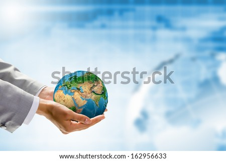 Image of Earth planet in human hands. Protect planet.  - stock photo