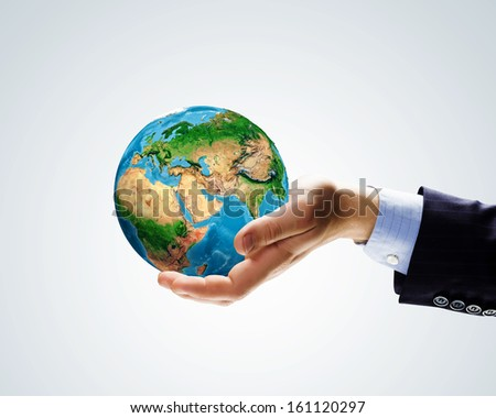 Image of Earth planet in human hands. Protect planet. Elements of this image are furnished by NASA - stock photo