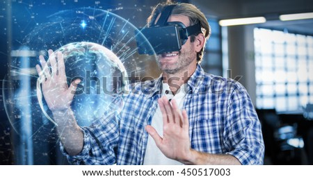 Image of earth with different times against businessman using virtual reality simulator - stock photo