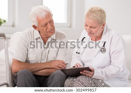 Image of elderly male patient during medical interview - stock photo