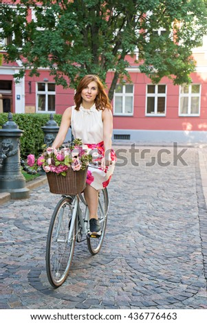 image of elegant woman in skirt with bike - stock photo