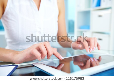 Image of female hands touching screen of digital tablet - stock photo