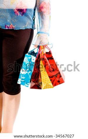 Image of female holding shoppingbags in her hand - stock photo
