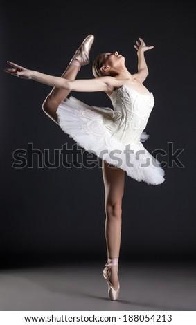Image of flexible cute ballerina dancing in studio - stock photo