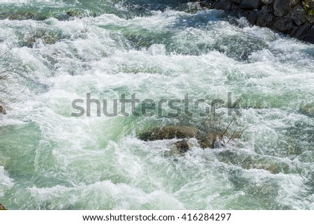 image of flowing water in the river - stock photo