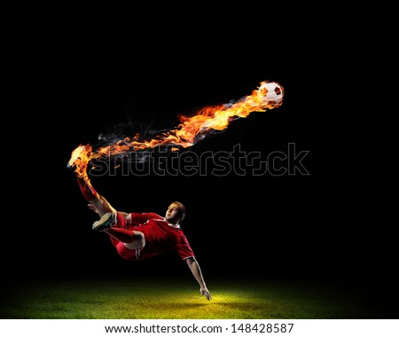 Image of football player in red shirt - stock photo