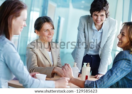 Image of four businesswomen having friendly talk - stock photo